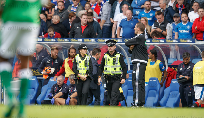 Police standing in front of the dugouts