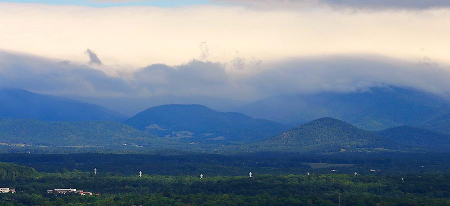 the Blue Ridge Mountains rise up behind Charlottesville, Va.