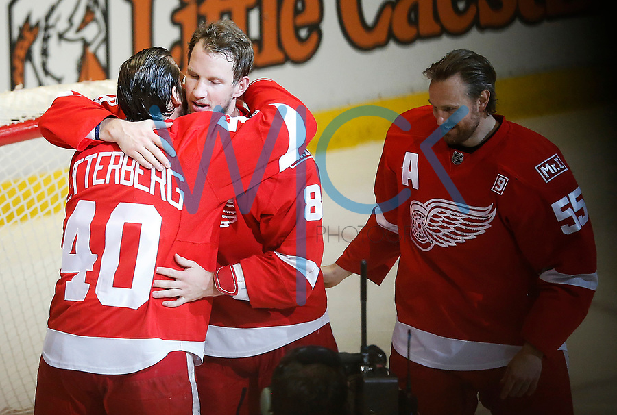 Justin Abdelkader #8 hugs teammate Henrik Zetterberg #40 prior to the start of the game against the New Jersey Devils at Joe Louis Arena in Detroit, Michigan on Sunday April 9, 2017. (Photo by Jared Wickerham/The Players Tribune)
