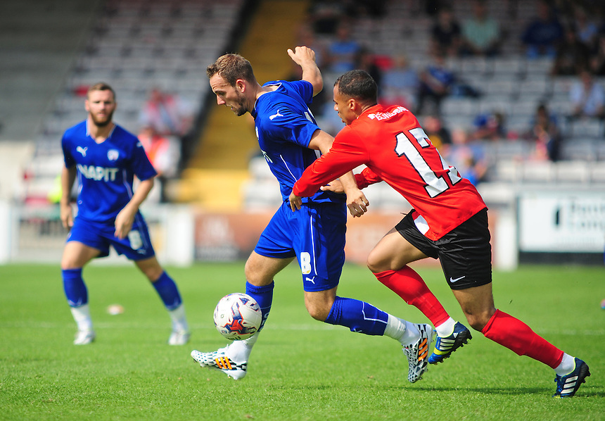 Chesterfield's Dan Gardner shields the ball from Lincoln City's Jake Caprice<br /> <br /> Photographer Chris Vaughan/CameraSport<br /> <br /> Football - Friendly - Lincoln City v Chesterfield - Saturday 19th July 2014 - Sincil Bank Stadium - Lincoln<br /> <br /> &copy; CameraSport - 43 Linden Ave. Countesthorpe. Leicester. England. LE8 5PG - Tel: +44 (0) 116 277 4147 - admin@camerasport.com - www.camerasport.com