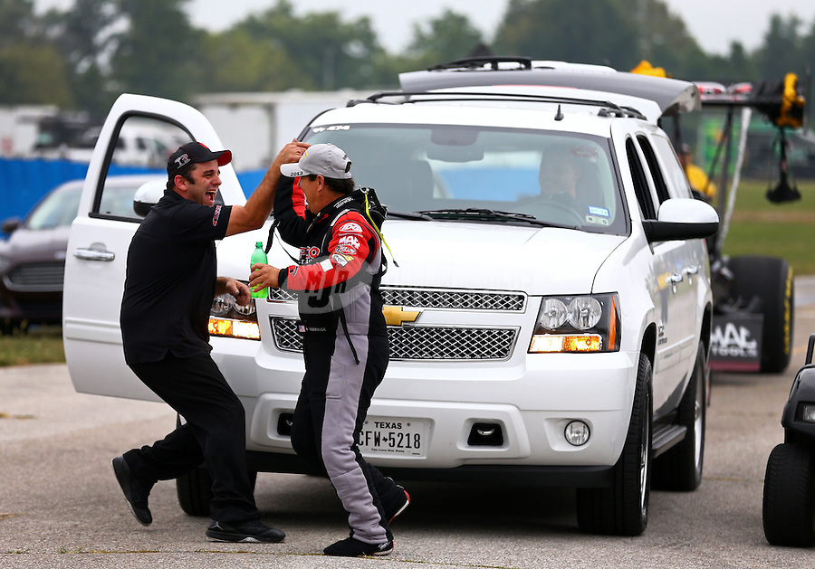 Sept. 2, 2013; Clermont, IN, USA: NHRA top fuel dragster driver Billy Torrence (right) celebrates with a crew member after winning his first pro round of eliminations during the US Nationals at Lucas Oil Raceway. Mandatory Credit: Mark J. Rebilas-