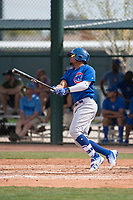 Chicago Cubs right fielder Eddy Martinez (25) follows through on his swing during a Minor League Spring Training game against the Oakland Athletics at Sloan Park on March 13, 2018 in Mesa, Arizona. (Zachary Lucy/Four Seam Images)