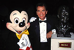 Dick Clark ( Inductee ) with Mickey Mouse.Attending the Academy of Television, Arts and Sciences Hall of Fame Inductions at Walt Disney World in Orlando, Florida..October 5, 1996.