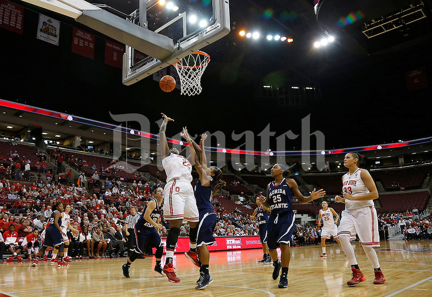 Ohio State Buckeyes center Darryce Moore (22) sinks a basket under pressure from Florida Atlantic Owls guard Ashley Stevenson (11) in the second half of the college basketball game between the Ohio State Buckeyes and the Florida Atlantic Owls at Value City Arena in Columbus,  Sunday afternoon, November 10, 2013. The Ohio State Buckeyes narrowly defeated the Florida Atlantic Owls 91 - 88. (The Columbus Dispatch / Eamon Queeney)