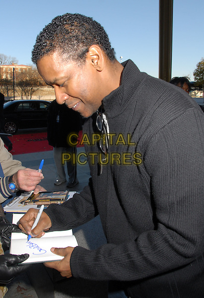 DENZEL WASHINGTON.31st Kennedy Center Honors celebrating lifetime achievement in the performing arts held at the Kennedy Center for the Performing Arts, Washington, D.C., USA..December 7th, 2008.half length black top profile signing autograph .CAP/ADM/LF.©Laura Farr/AdMedia/Capital Pictures.