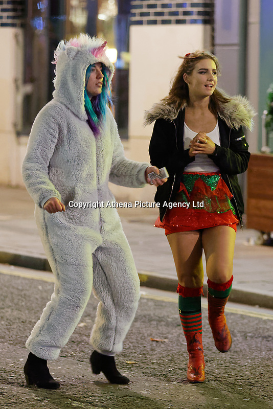 Pictured: Two young women in festive dresses. Friday 14 December 2018<br /> Re: Revellers in Wind Street, Swansea, Wales, UK.