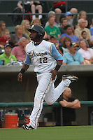 Myrtle Beach Pelicans shortstop Hanser Alberto #12 scoring from third during a game against the Winston-Salem Dash at Ticketreturn.com Field at Pelicans Park on July 11, 2012 in Myrtle Beach, South Carolina. Myrtle Beach defeated Winston-Salem by the score of 7-1. (Robert Gurganus/Four Seam Images)