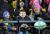 Fans return the matchball to play during the Super Rugby match between the Hurricanes and Blues at Westpac Stadium, Wellington, New Zealand on Saturday, 2 July 2016. Photo: Dave Lintott / lintottphoto.co.nz