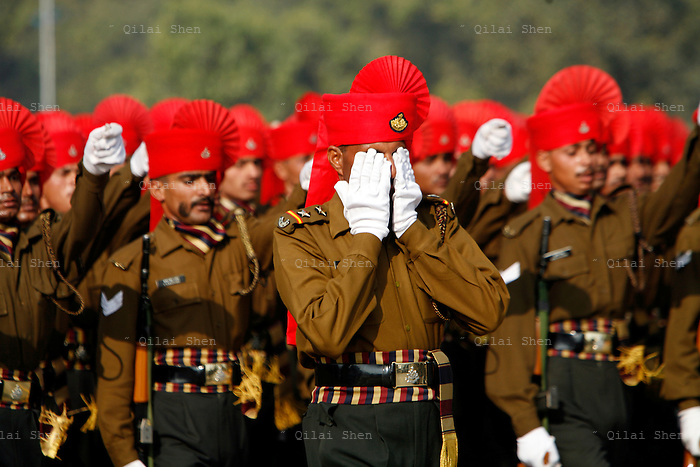 An Indian officer covers his face in fatigue while leading his men in formation down Raj Path during a rehearsal for the Republic Day parade in New Delhi, India on Thursday 18 January 2007.