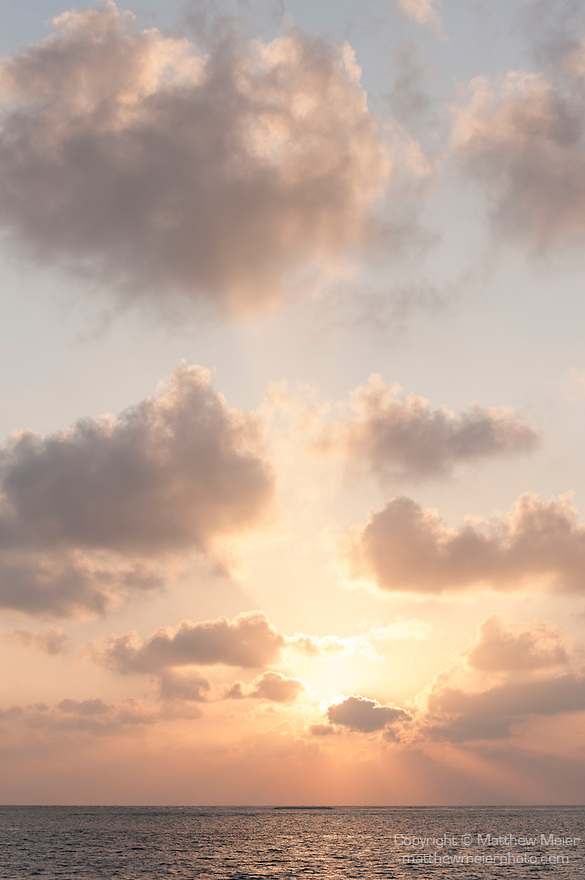 Alimatha, Felidhoo Atoll, Maldives; colorful, sunrise skies over the Indian ocean