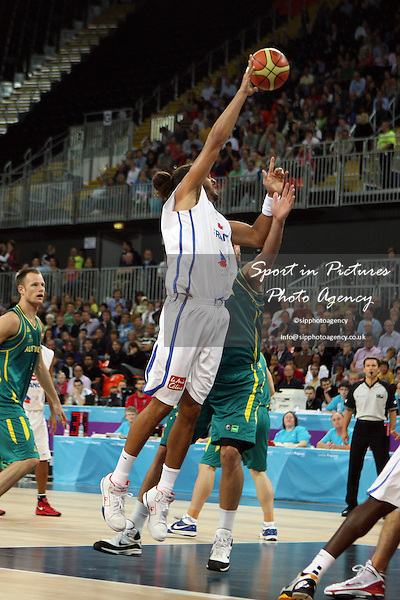 Joakim Noah (France) in action. France v Australia. The London International Basketball Invitational. London Prepares for Olympics 2012. Basketball Arena, Olympic Park. London. 17/08/2011. MANDATORY Credit Sportinpictures/Paul Chesterton - NO UNAUTHORISED USE - 07837 394578.