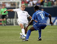 Stuart Holden (10) pokes the ball away from Carlos Palacios (14).  The US Men's National Team defeated Honduras 2-0 in the semifinals of the Gold Cup at Soldier Field in Chicago, IL on July 23, 2009.