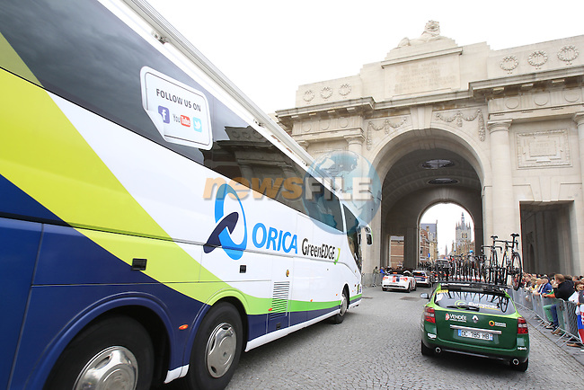 Orica GreenEdge team arrive in Ypres through the Menin Gate for the start of the cobbled stage Stage 5 of the 2014 Tour de France running 155.5km from Ypres to Arenberg. 9th July 2014.<br /> Picture: Eoin Clarke www.newsfile.ie