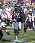 Nevada's quarterback #12 Carson Strong avoids the rush during the Nevada vs Weber State football game in Reno, Nevada on Saturday, Sept. 14, 2019.