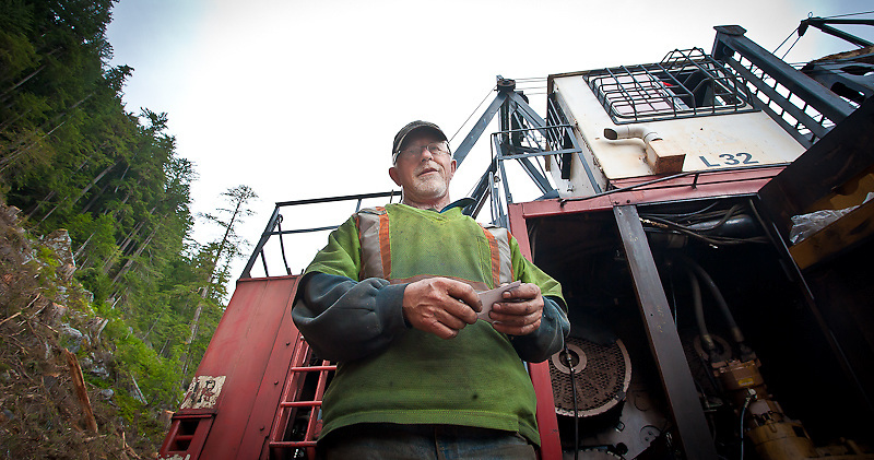 Cal Livingston (loader operator) in front of his line loader up the Kleena Kleene River valley, Knight Inlet, July 2012.