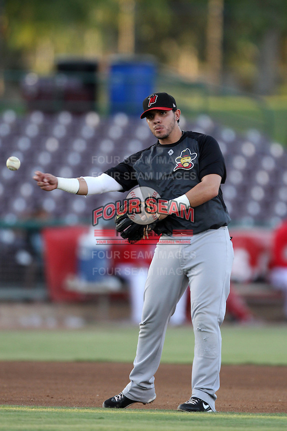 Carlos Ramirez #4 of the High Desert Mavericks throws during a game against the Inland Empire 66'ers at San Manuel Stadium on August 26, 2012 in San Bernardino, California. High Desert defeated Inland Empire 4-0. (Larry Goren/Four Seam Images)