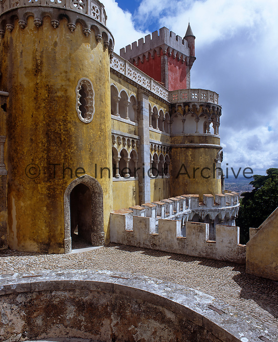 A view of the Moorish style turrets and castellated parapet of the Palacio de Pena in Sintra