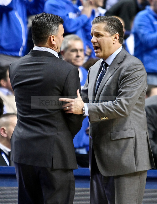 Kentucky head coach John Calipari and Columbia head coach Kyle Smith shake hands after Kentucky defeated Columbia 56-46 after the UK men's basketball game vs. Columbia at Rupp Arena in Lexington , Ky., on Wednesday, December 10, 2014. Photo by Jonathan Krueger | Staff