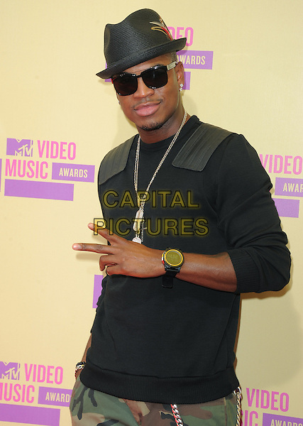 Ne-Yo (Shaffer Chimere Smith, Jr.).The 2012 MTV Video Music Awards held at Staples Center in Los Angeles, California, USA..September 6th, 2012.VMA's VMAS VMA half length black top hat sunglasses shades necklace hand v peace sign silver watch .CAP/RKE/DVS.©DVS/RockinExposures/Capital Pictures.