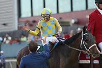 HOT SPRINGS, AR - April 15: Norman Casse and jockey Julien Leparoux high five after Classic Empire #2  wins the Arkansas Derby at Oaklawn Park on April 15, 2017 in Hot Springs, AR. (Photo by Ciara Bowen/Eclipse Sportswire/Getty Images)