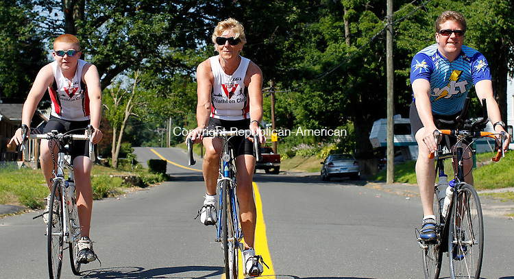 Watertown, CT-05, June 2010-070510CM05  (L-R) Jake Steel, 13, his grandmother, Joan and father Dave, ride their bikes, which will be used when the compete in this years 24th annual BMW of Watertown Pat Griskus Sprint Triathlon.  This will be Jake's first Tri, as her father and grandmother are veterans and have competed in triathlons all over the state.  The 1/2mi open water swim, 10 mile bike and 3.1 mile run is scheduled to begin Wednesday evening at Lake Quassy in Middlebury. --Christopher Massa Republican-American