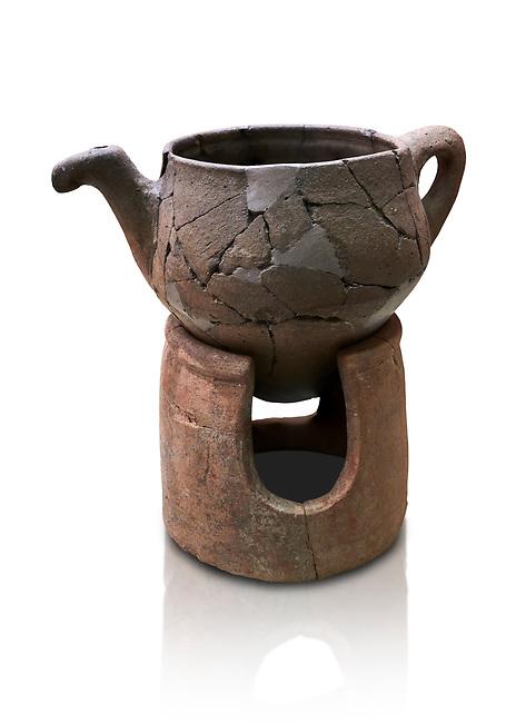 Hittite terra cotta teapot with strainer spout on a charcoa; burner base  . Hittite Period, 1600 - 1200 BC.  Hattusa Boğazkale. Çorum Archaeological Museum, Corum, Turkey. Against a white bacground.