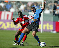 San Jose Earthquakes' Eddie Robinson, right, and Chicago Fire's Damani Ralph, left, battle for a ball in the 2003 MLS Championship, in Carson, Calif.