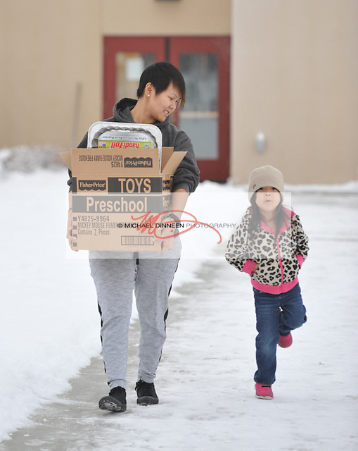 Eagle River's Robyn Michael and daughter Jaeden leave St. Andrew's with a meal and gifts for Christmas. Photo for the Star by Michael Dinneen