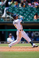 Montgomery Biscuits shortstop Andrew Velazquez (5) follows through on a swing during a game against the Mississippi Braves on April 25, 2017 at Montgomery Riverwalk Stadium in Montgomery, Alabama.  Mississippi defeated Montgomery 3-2.  (Mike Janes/Four Seam Images)