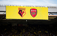 Team displayed on a board above Watford supporters pre match during the Premier League match between Watford and Arsenal at Vicarage Road, Watford, England on 16 September 2019. Photo by Andy Rowland.
