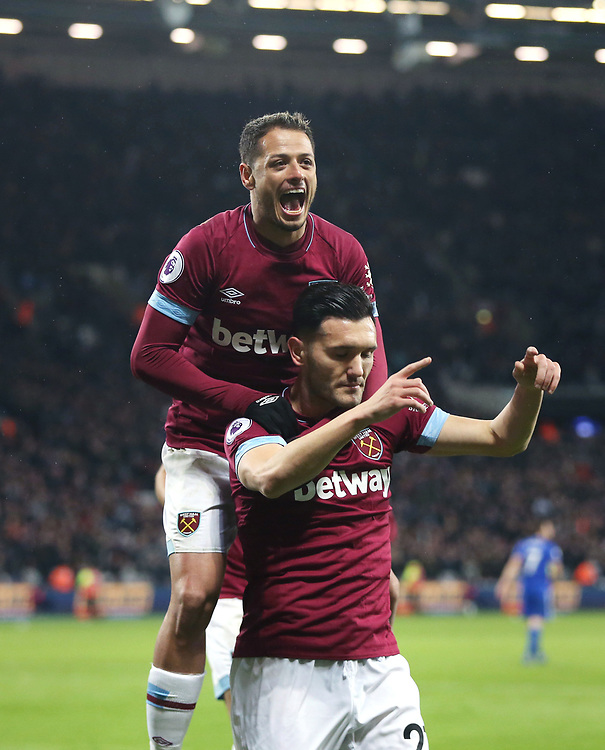 West Ham United's Lucas celebrates scoring his side's second goal with Javier Hernandez<br /> <br /> Photographer Rob Newell/CameraSport<br /> <br /> The Premier League - West Ham United v Cardiff City - Tuesday 4th December 2018 - London Stadium - London<br /> <br /> World Copyright © 2018 CameraSport. All rights reserved. 43 Linden Ave. Countesthorpe. Leicester. England. LE8 5PG - Tel: +44 (0) 116 277 4147 - admin@camerasport.com - www.camerasport.com
