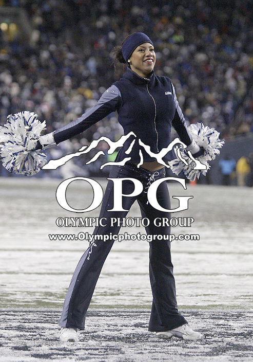 27 Nov 2006:  Seattle Seahawk cheerleaders battled rain and snow while entertaining the fans during Monday night football against the Green Bay Packers at Qwest Field in Seattle, Washington. The Seattle Seahawks defeated the Green Bay Packers 34-24.