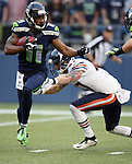 Seattle Seahawks wide receiver/kick off return specialist Percy Harvin returns a kickoff for 46-yards against the Chicago Bears in  a pre-season game at CenturyLink Field in Seattle, Washington on August 12, 2014.  Seattle beat Chicago 34-6. © 2014.  Jim Bryant Photo. ALL RIGHTS RESERVED.