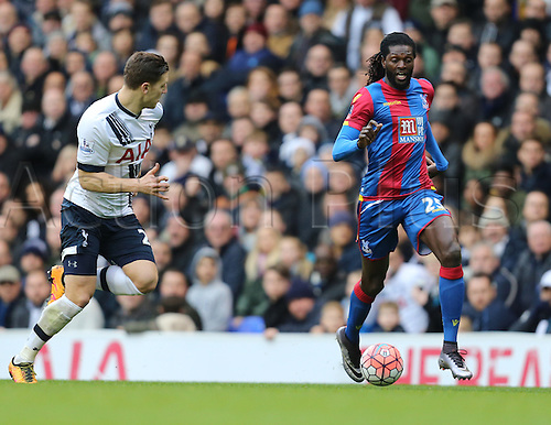 21.02.2016. White Hart Lane, London, England. Emirates FA Cup 5th Round. Tottenham Hotspur versus Crystal Palace. Emmanuel Adebayor runs with the ball covered by Wimmer (THFC)