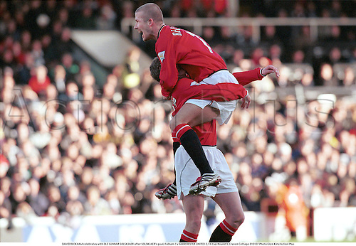 DAVID BECKHAM celebrates with OLE GUNNAR SOLSKJAER after SOLSKJAER's goal, Fulham 1 v MANCHESTER UNITED 2, FA Cup Round 3, Craven Cottage 010107 Photo:Glyn Kirk/Action Plus...2001.Soccer.PREMIER LEAGUE.football.english premiership club clubs.association.celebration.celebrate.celebrating.celebrations.joy