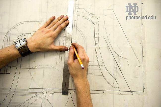 Sept. 3, 2014; Graduate student Benjamin Sunderlin works  in his studio in Riley Hall. (Photo by Barbara Johnston/University of Notre Dame