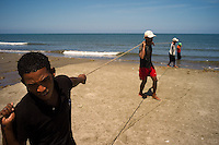 Fishermen drag net lines ashore along the Caribbean beaches near Cartagena, Colombia.