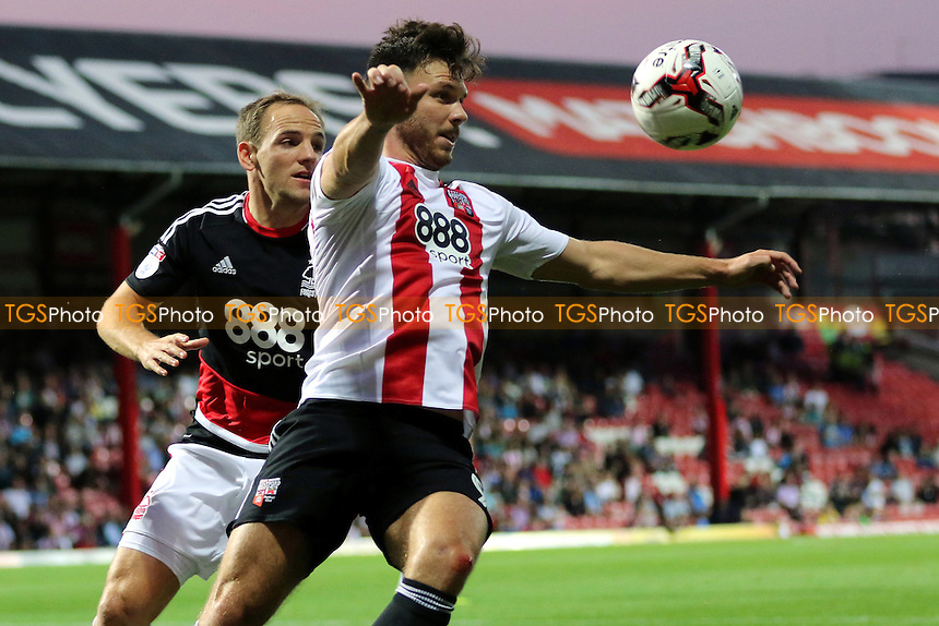 Scott Hogan of Brentford controls the ball as Nottingham Forest's David Vaughan looks on during Brentford vs Nottingham Forest, EFL Championship Football at Griffin Park on 16th August 2016