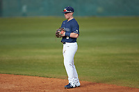 Wingate Bulldogs second baseman McCann Mellett (9) on defense against the Concord Mountain Lions at Ron Christopher Stadium on February 1, 2020 in Wingate, North Carolina. The Bulldogs defeated the Mountain Lions 8-0 in game one of a doubleheader. (Brian Westerholt/Four Seam Images)
