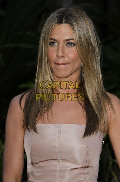 "JENNIFER ANISTON.""The Switch"" Los Angeles Premiere held at Arclight Cinemas, Hollywood, California, USA..August 16th, 2010.half length strapless beige nude lips mouth funny face .CAP/ADM/CH.©Charles Harris/AdMedia/Capital Pictures"