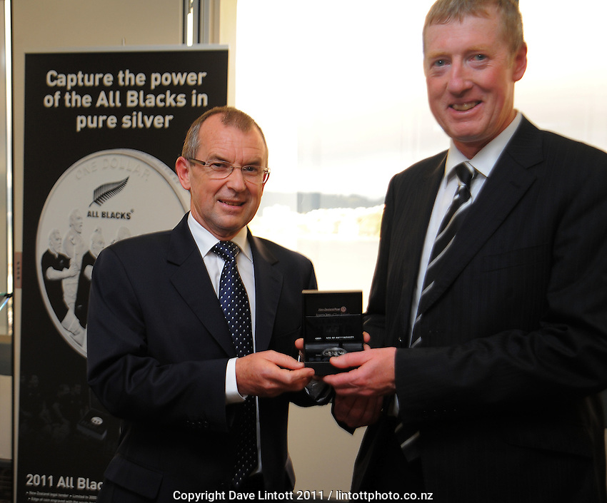 NZ Post chief exective Brian Roche presents NZRU representative Paul Dalton with the haka coin. NZ Post 2011 haka coin launch at NZ Post head office, Wellington, New Zealand on Tuesday, 30 August 2011. Photo: Dave Lintott / lintottphoto.co.nz