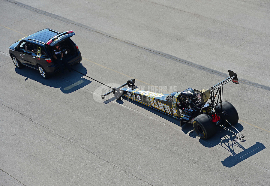 Sept. 29, 2012; Madison, IL, USA: NHRA top fuel dragster driver Tony Schumacher being towed back to the pits during qualifying for the Midwest Nationals at Gateway Motorsports Park. Mandatory Credit: Mark J. Rebilas-