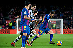 Lionel Andres Messi (R) of FC Barcelona fights for the ball with players of Levante UD during the La Liga 2017-18 match between FC Barcelona and Levante UD at Camp Nou on 07 January 2018 in Barcelona, Spain. Photo by Vicens Gimenez / Power Sport Images