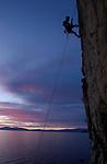 NV-SAS68..Climber Jobe Pilgrim, a life-long resident of South Lake Tahoe, climbs up a rock wall just north of South Lake Tahoe, NV, Monday evening May 12, 2003.