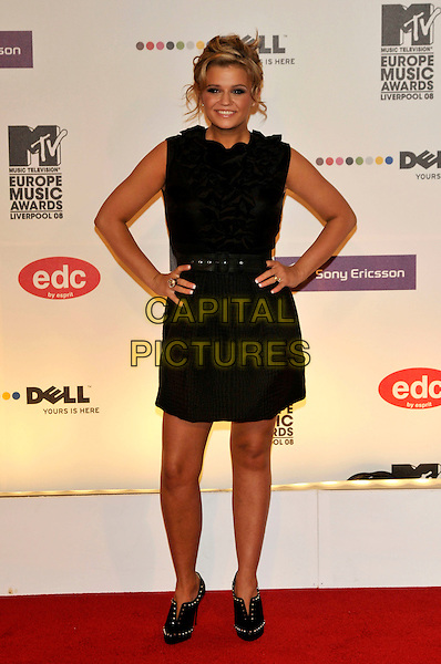 KERRY KATONA.2008 MTV Europe Music Awards arrivals at Echo Arena, Liverpool, England..6th November 2008.EMA full length black sleeveless dress ruffled ruffles hands on hips ankle shoe boots .CAP/PL.©Phil Loftus/Capital Pictures.