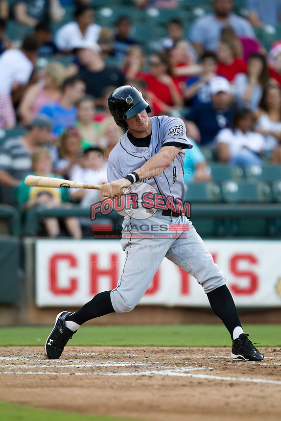 Omaha Storm Chasers outfielder Wil Myers #8 swings during the Pacific Coast League baseball game against the Round Rock Express on July 22, 2012 at the Dell Diamond in Round Rock, Texas. The Express defeated the Chasers 8-7 in 11 innings. (Andrew Woolley/Four Seam Images).