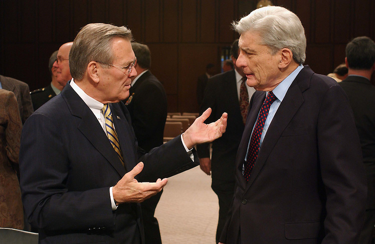 2/13/03.DEFENSE AUTHORIZATION REQUEST--Chairman John W. Warner, R-Va., right, and Defense Secretary Donald H. Rumsfeld talk before the Senate Armed Services hearing on the defense authorization request for Fiscal Year 2004 and on the defense program of the future. Gen. Richard B. Myers, USAF chairman of the Joint Chiefs of Staff, also testified..CONGRESSIONAL QUARTERLY PHOTO BY SCOTT J. FERRELL