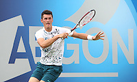 11.06.13 London, England. Bernard Tomic (AUS) in action against Benjamin Becker (GER) during the The Aegon Championships from the The Queen's Club in West Kensington.