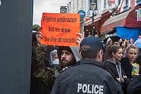 Anti fascists clash with supporters at 'March for England' in Brighton. 27-4-14 A massive Police operation costing an alleged £500,000 was deployed in Brighton to keep antifascists and supporters of the racist and nationalist 'March for England' apart. Anti fascists clashed with racists in the side streets, heckled their parade along the sea front and built barricades to delay the racists being escorted back to the station under heavy police protection. The police deployed horses, dogs and riot squads making several arrests.