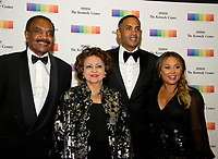 From left to right: Calvin Hill, wife Janet, Grant Hill and wife Tamia, arrive for the formal Artist's Dinner honoring the recipients of the 40th Annual Kennedy Center Honors hosted by United States Secretary of State Rex Tillerson at the US Department of State in Washington, D.C. on Saturday, December 2, 2017. The 2017 honorees are: American dancer and choreographer Carmen de Lavallade; Cuban American singer-songwriter and actress Gloria Estefan; American hip hop artist and entertainment icon LL COOL J; American television writer and producer Norman Lear; and American musician and record producer Lionel Richie.  <br /> Credit: Ron Sachs / Pool via CNP /MediaPunch
